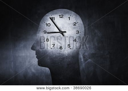 Conceptual image of a clock superimposed on a head of a human.