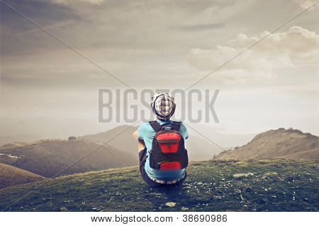 Young traveler watching a landscape