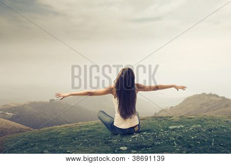 Girl enjoying the freedom in a wasteland