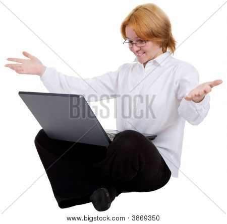 Woman Sitting On A Floor With The Notebook