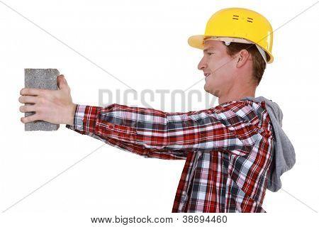 Mason carrying building block