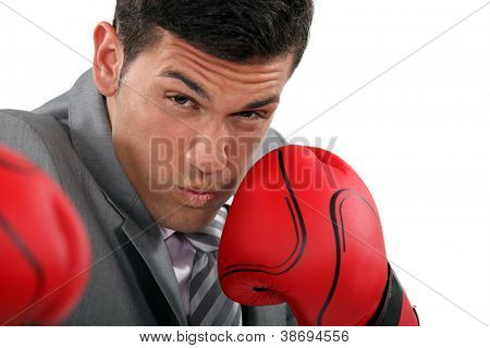 Businessman throwing punches