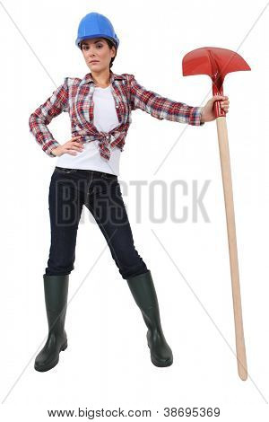 cute female bricklayer holding shovel
