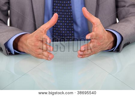 closeup on businessman's hands during speech