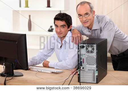 Colleagues working on a PC