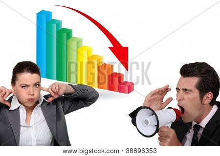 Business people with a downward graph and loudspeaker