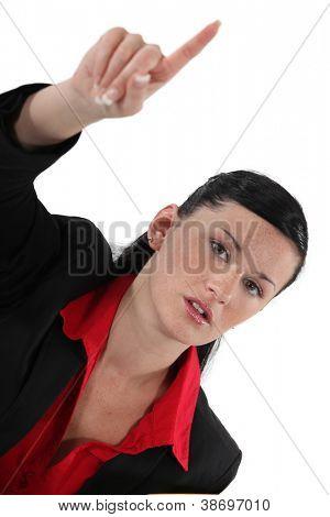 Businesswoman raising her hand