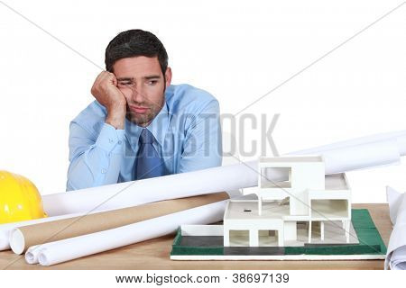 Bored architect sat at desk