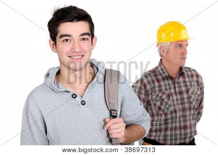 young apprentice posing next to craftsman