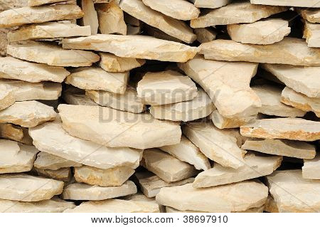 Heap of flat paving stones limestone
