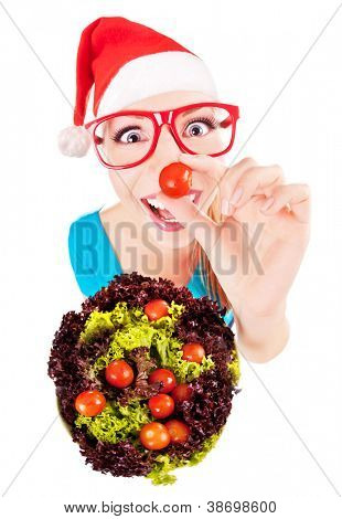 Cheerful funny xmas girl playing with salad, isolated on white, fish eye lens shot