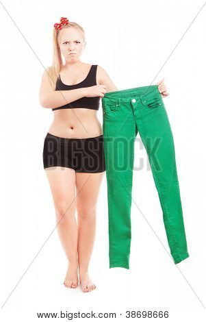 Angry 40 size girl holding 36 size trousers