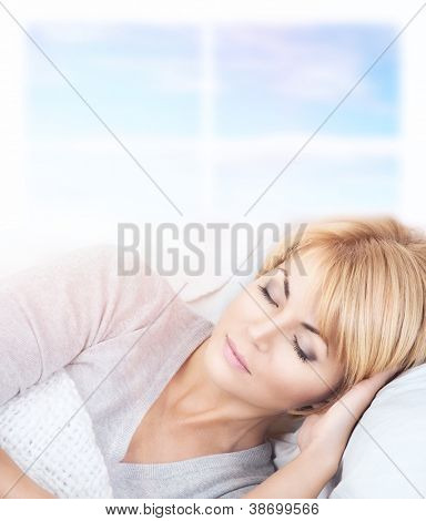 bright closeup picture of beautiful sleeping woman.