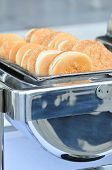 stock photo of chafing  - sesame buns for burgers served in a catering dish - JPG