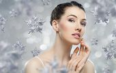 stock photo of cold-shoulder  - beautiful girl on the background of snow - JPG
