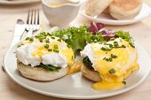 Eggs Florentine- toasted English muffins, ham, poached eggs, and delicious buttery hollandaise sauce