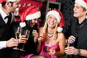 stock photo of bartender  - Christmas party cheerful friends at having drink and fun - JPG