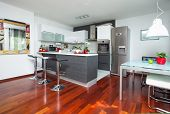 stock photo of stool  - Beautiful modern kitchen in designer house - JPG