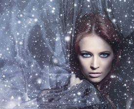 pic of magi  - Fashion shoot of young attractive woman in blowing silk over the snowy background - JPG