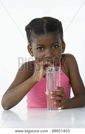 Portrait of an African American young girl drinking mocktail