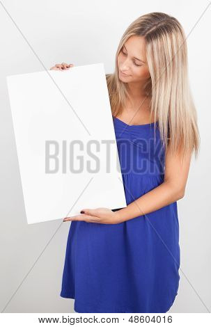 Portrait Of A Young Woman Holding A Blank Billboard
