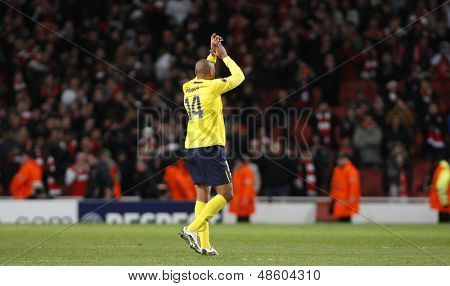 LONDON, ENGLAND. 31/03/2010. Barcelona player Thierry Henry salutes the Arsenal fans on his return to the North London Club at the  UEFA Champions League quarter-final at the Emirates Stadium