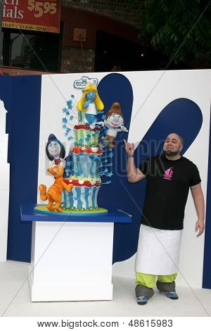 LOS ANGELES - JUL 28:  Duff Goldman with the Smurfs 2 cake by Charm City Cakes arrives at the