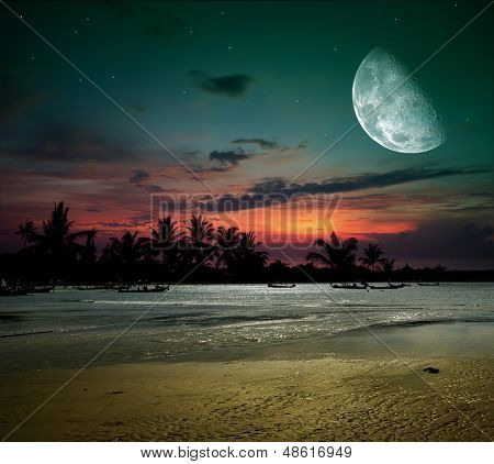 Tropical night. Fishermen go out in the ocean