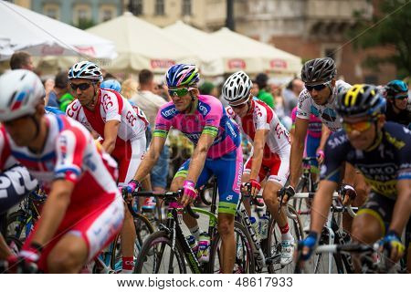 KRAKOW, POLAND - JULY 30: Unidentified participants of 70th Tour de Pologne cycling 3rd stage race, July 30, 2013 in Krakow, Poland. Tour de Pologne, the biggest cycling event in Eastern Europe.