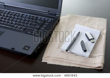 Office Desk With Computer Newspaper Pen Usb Drive And Notebook
