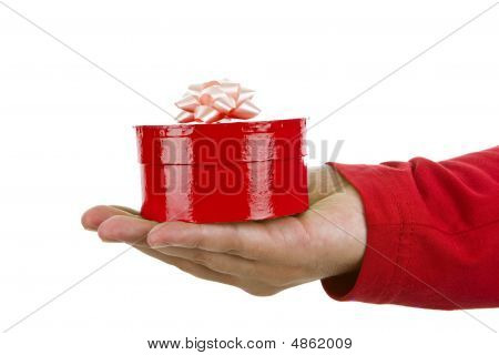 Hand Holding A Red Christmas Gift