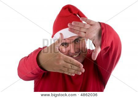 Man Wearing Red Santa Hat Doing A Photo Frame With The Hands