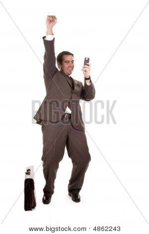 Happy Businessman With Cellular Phone