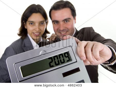 Business Team Holding A Calculator - New Year Resolution - 2009