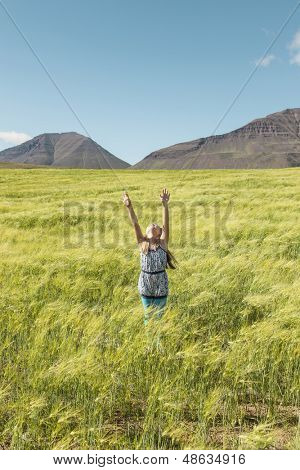 Young girl embracing faith stretching hands into the sky