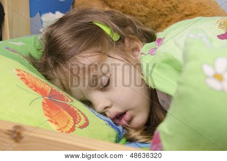Four-year-old girl sleeping in the crib