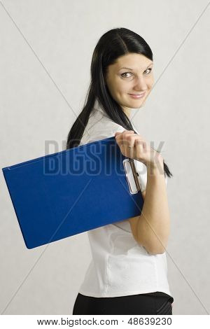 Business girl keeps the folder with the documents