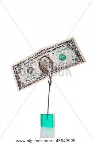 Paper US Dollar attached with a clipper.