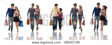 Happy young couples coming back from shopping collection.