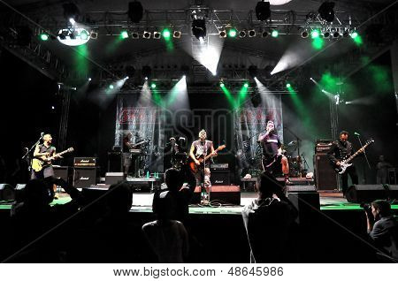 Ska-P pun rock band performs live on the stage during a concert