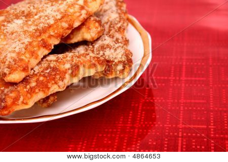 Triangular Cookies In A Plate On Red Background