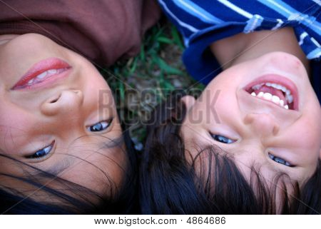 Little Boy And Girl Happy Upside Down