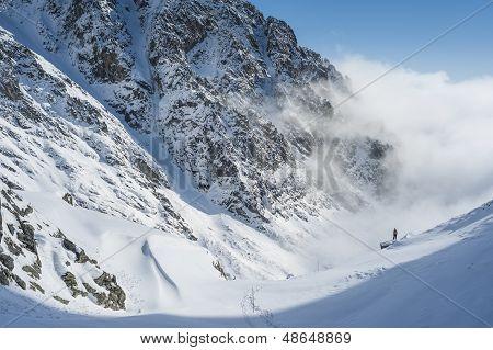 Walker In Mountains