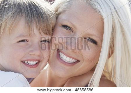 Closeup portrait of happy little boy and mother cheek to cheek