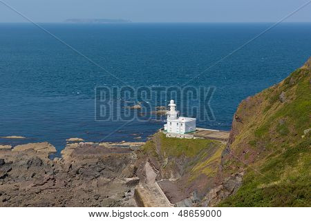 Lighthouse on rock and blue sea