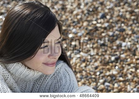 Closeup of thoughtful young woman looking away at beach