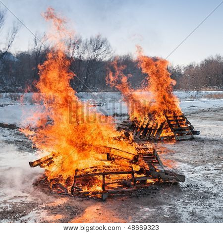 Two Pallet Fires Burn Brightly