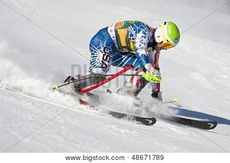 VAL D'ISERE FRANCE. 12-12-2010. MILLER Bode USA  straddles a control gate and is disqualified in the FIS alpine skiing world cup slalom race on the Bellevarde race piste Val D'Isere.