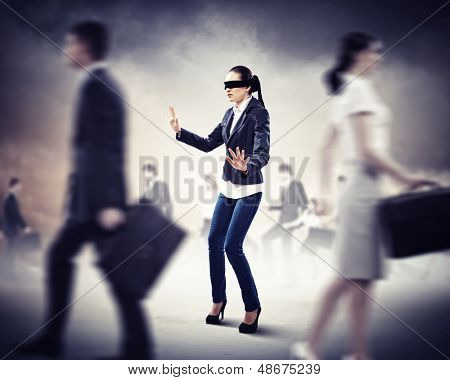 Image of businesswoman in blindfold walking among group of people