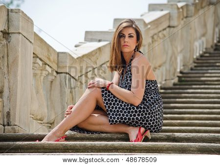 Gorgeous Girl Sitting On Marble Stairs